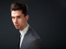 Handsome young fashion model with cool hairstyle Royalty Free Stock Photography