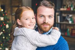 Father. Handsome young father embracing with beautiful daughter Royalty Free Stock Image
