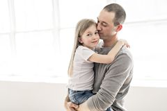 Handsome young father and his cute little daughter stock image