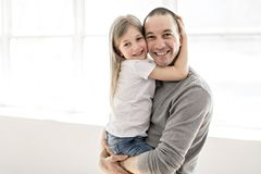 Handsome young father and his cute little daughter stock photography