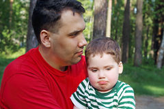 Handsome young father with little cute son sit Royalty Free Stock Photography