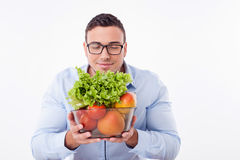 Handsome young fit man prefers healthy eating Stock Photography