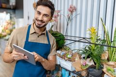 Male florist with digital tablet Royalty Free Stock Photo