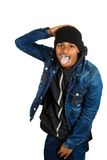Handsome young funky man sticking his tongue out posing royalty free stock photo