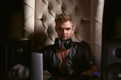 Handsome young gay musician DJ in headphones Stock Photography