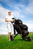 Handsome young golfer Royalty Free Stock Images