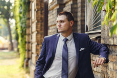 Handsome young groom on their wedding day Stock Photography