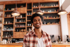 Handsome young guy in a coffee shop Royalty Free Stock Photos