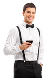 Handsome young guy drinking red wine Royalty Free Stock Photo