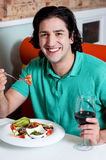 Handsome young guy enjoying his meal Royalty Free Stock Photos