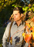 Handsome young guy in fall (autumn) at dusk. Attractive young male model in fall (autumn) outdoors in nature Stock Photos