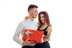 Handsome young guy gave the girl a big gift box Royalty Free Stock Photography
