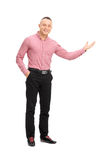 Handsome young guy gesturing with his hand Stock Photos