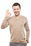 Handsome young guy is gesturing positively Stock Photo