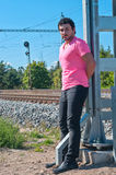 Handsome young guy in pink t-shirt Stock Photography