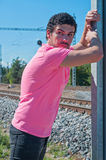 Handsome young guy in pink t-shirt Royalty Free Stock Image