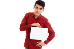 Handsome young guy in red shirt with empty placard in hands posing isolated on white background Royalty Free Stock Photos
