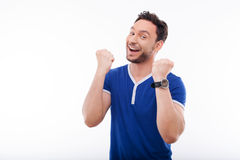 Handsome young guy is showing his positive emotion Stock Image