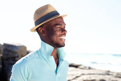 Handsome young guy smiling at the beach Royalty Free Stock Photos