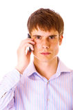 Handsome young guy speaking on cellphone Royalty Free Stock Images