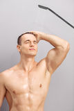 Handsome young guy taking a shower Stock Photos