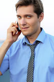 Handsome young guy using a mobile phone Stock Photography