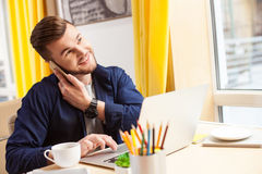 Handsome young guy is using a telephone Stock Photos