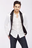 Handsome young guy wearing white jacket royalty free stock images