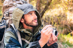 Handsome young hiker with camera Stock Photography