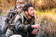 Handsome young hiker with camera Royalty Free Stock Images