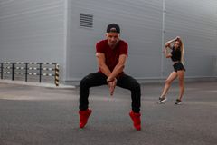 Handsome young hip-hop man dancer in a red fashionable T-shirt royalty free stock photography