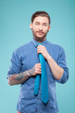 Handsome young hipster is caring of his image royalty free stock image