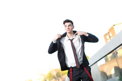 Handsome young hipster fashion male model. Wearing shirt and red braces posing outdoors Royalty Free Stock Images
