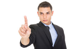 Handsome young Hispanic businessman pointing Stock Photos