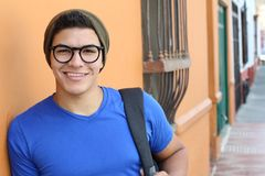 Handsome young hispanic male smiling outdoors.  royalty free stock photography