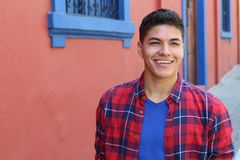 Handsome young hispanic male smiling outdoors.  royalty free stock photo