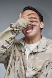 Good Looking Male Soldier Laughing. A handsome young hispanic man Royalty Free Stock Photo