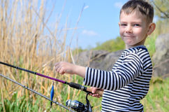 Handsome Young Kid Holding his Fishing Rod Royalty Free Stock Image