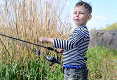 Handsome Young Kid Holding his Fishing Rod Stock Photos