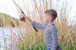 Handsome Young Kid Holding his Fishing Rod Stock Image