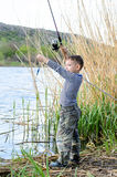 Handsome Young Kid Holding his Fishing Rod Royalty Free Stock Photos