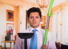 Handsome young mad Man holding vacuum cleaner.  Royalty Free Stock Photo