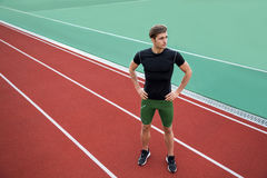 Handsome young male athlete standing outdoors Royalty Free Stock Images