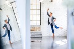 A handsome young male Ballet dancer practicing in a Loft style A. Partment Stock Images