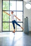 A handsome young male Ballet dancer practicing in a Loft style A. Partment Royalty Free Stock Images