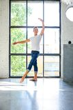 A handsome young male Ballet dancer practicing in a Loft style A stock image
