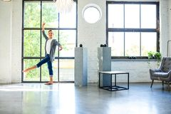 A handsome young male Ballet dancer practicing in a Loft style A. Partment Stock Photos