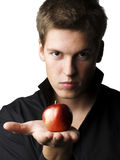 Handsome young male model holding an apple Stock Images