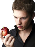 Handsome young male model holding an apple Royalty Free Stock Photography