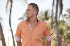 Handsome young male in an orange shirt Stock Photo
